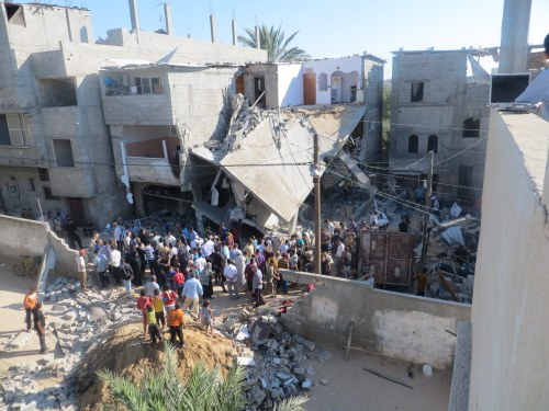The home of the Kware' family, after it was bombed by the military, while family members and neighbors were present inside the house and in its vicinity (Photo: Muhammad Sabah, Gaza 8 July 2014).